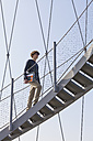 Germany, Stuttgart, Teenage boy climbing stairs of Killesberg Tower - WDF002421