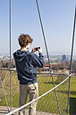Germany, Stuttgart, Teenage boy taking photograph from Killesberg Tower - WDF002422