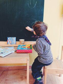 little boy paints on the blackboard, Potsdam, Germany - AF000046