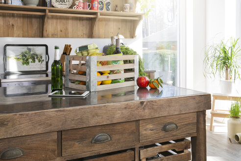 Crate of groceries in country style kitchen - FKF000473