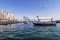 United Arab Emirates, Dubai, Boat in water and skyline of city center - THA000176