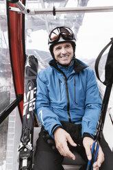 Germany, Bavaria, Winklmoosalm, Mature man in ski lift - MF000925