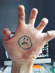 Sad Smiley on hand in office - MEAF000223