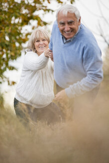 Smiling senior couple on the move - WESTF019227