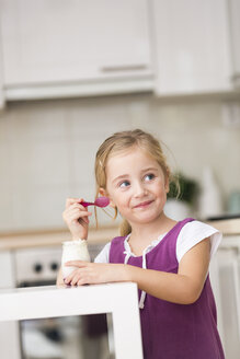 Portrait of little girl eating yogurt - WESTF019115