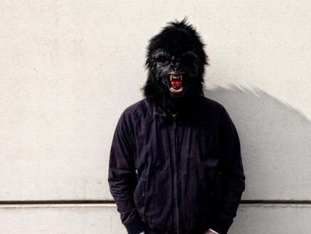Germany, Berlin, man with gorilla mask - TKF000316