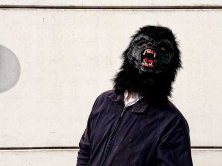 Germany, Berlin, man with gorilla mask - TKF000319