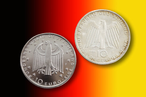 Two German commemorative coins in front of national colours - CS021085