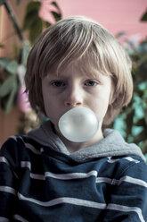 Portrait of little bow blowing gum bubble - SARF000426