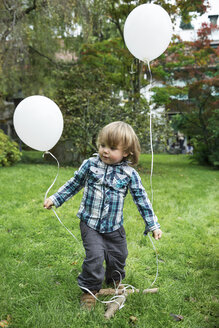 Toddler with balloons in garden - ABF000561