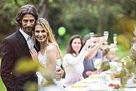 Bride and groom on a garden party - ABF000535