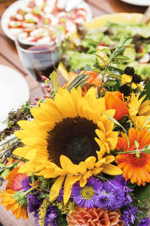 Bunch of flowers on garden table - ABF000521