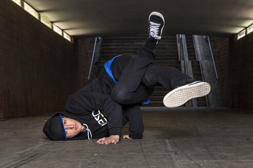 Germany, portrait of young break dancer in underpass - STS000379