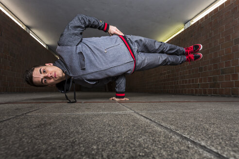 Germany, portrait of young break dancer in underpass - STS000370