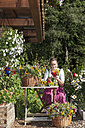 Austria, Altenmarkt, Farmer's woman binding bouquets - HHF004787