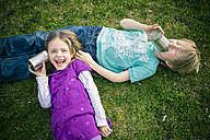 Boy and girl having fun with tin can phone - SARF000407
