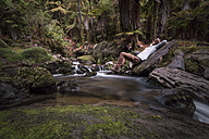 New Zealand, Whakapapa area, Tupapakurua falls, man lying on a brook - WV000552