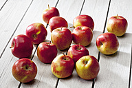 Braeburn apples on grey wooden table - CSF021098