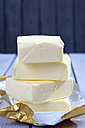Stack of four pieces of butter on reaseproof paper - CSF021137
