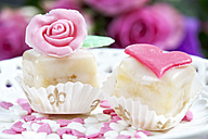 Two petit four and baking decor on cake stand - CSF021126