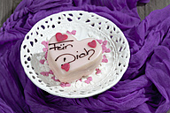 Petit four on cake stand and purple cloth - CSF021154