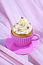 Baking dish formed like cup with decorated cupcake on pink cloth - CSF021142