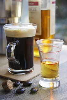 Cup of fresh coffee and a shot glass with whisky for marking Irish Coffee - HAWF000002