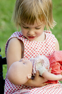 Little girl playing with doll - LVF000972