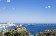 New Zealand, Northland, Cape Reinga area, Woman overlooking New Zealand's Top End and Tasman Sea, Cape Maria van Diemen - GW002691