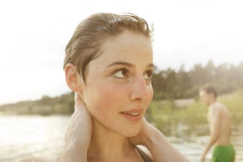Young woman enjoying bathing in quarry pond - MUMF000016