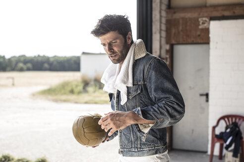 Portrait of man holding football - MUMF000037