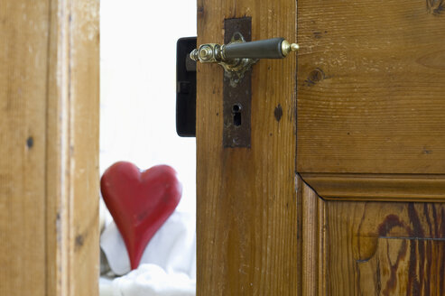 Germany, Bavaria, Wooden door with red heart - ASF005308