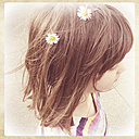 Germany, Baden-Wuerttemberg, girl with daisies in her hair - LVF000942