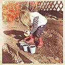 Germany, Baden-Wuerttemberg, girls planting, garden - LVF000939