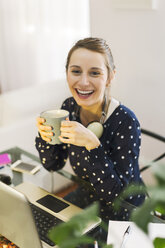 Young woman working with laptop at home - EBSF000133