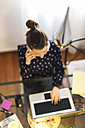 Young woman working with laptop at home - EBSF000138