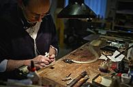 Violin maker repairing a bow - DIKF000085