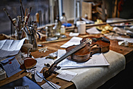 Tools and damaged instruments in a violin maker's workshop - DIKF000096