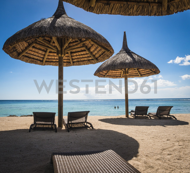 Mauritius, sunshades and beach chairs in front of the sea - DISF000695