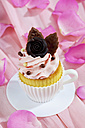 Baking dish formed like a cup with decorated cupcake on pink crepe paper - CSF021167