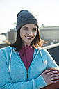 Portrait of smiling young sportswoman - UUF000158