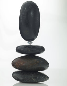Stack of stones, balancing on diamond - AKF000356