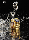 Golden ring with tanzanite and citrine, water splashing around - AKF000365