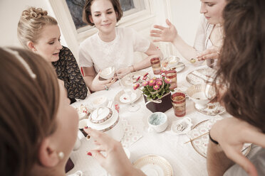 Young women on a retro style tea party - DISF000746