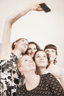 Young women in vintage dresses taking a selfie - DISF000754