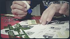 little boy working on little house for model railway - SBDF000712