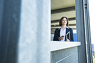 Portrait of business woman with smartphone and tablet computer - UUF000107