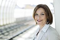Portrait of business woman waiting on platform - UUF000123