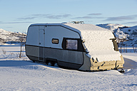 Norway, Karlebotn, Varangerfjord, Snowcovered camping trailer - SR000494