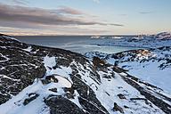 Norway, Karlebotn, Varangerfjord, Snow covered rock surface - SR000492